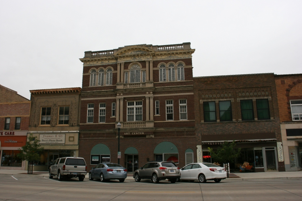 The Art Center is currently in a building across the street from the bank.