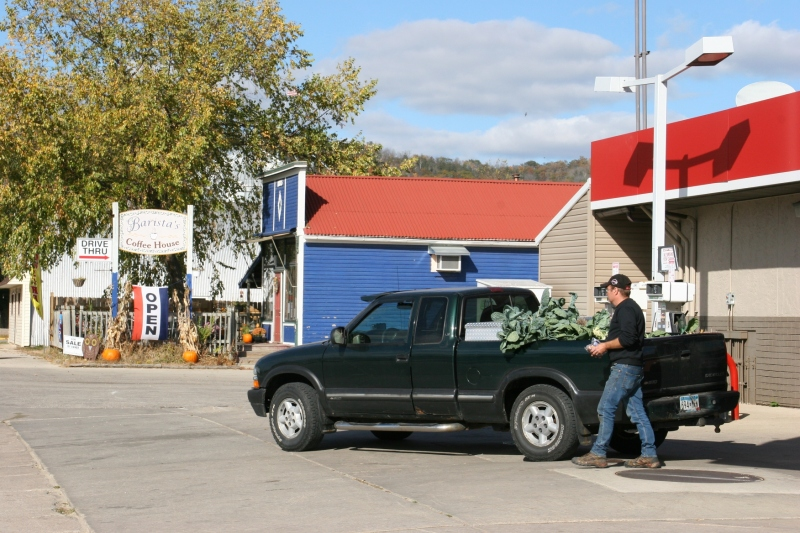 After photographing the hardware store mural, I turned to see this man walking to his pick-up truck parked across the street at River Valley Convenience Store. The business is owned by Doreen and Tom's son Brady and his wife, Tracy. It was the leafy vegetables in the pick-up bed that caught me eye.