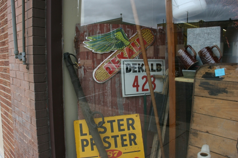 Agricultural merchandise is showcased in a downtown antique store window.