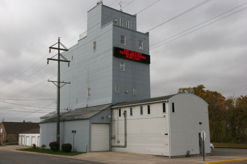 This old grain elevator has been repurposed into another use. Note the upper level balcony and windows. I asked around town. But no one could tell me what's housed here.