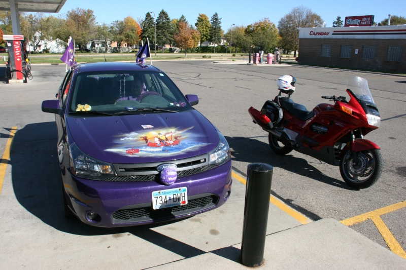 MN Vikings fan, 71 front of Vikings car