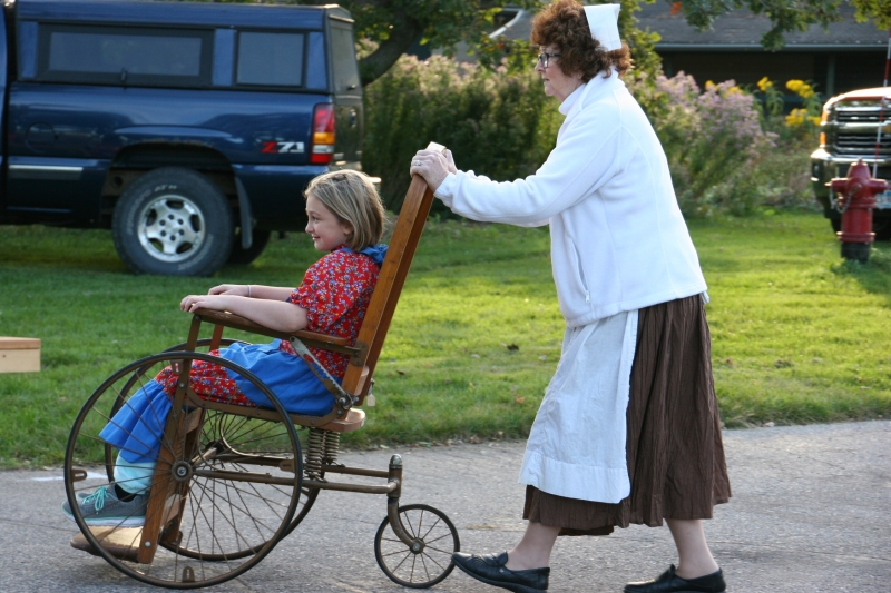 I expect this young girl will remember being pushed around in a wheelchair by a Red Cross nurse during this historical reenactment.