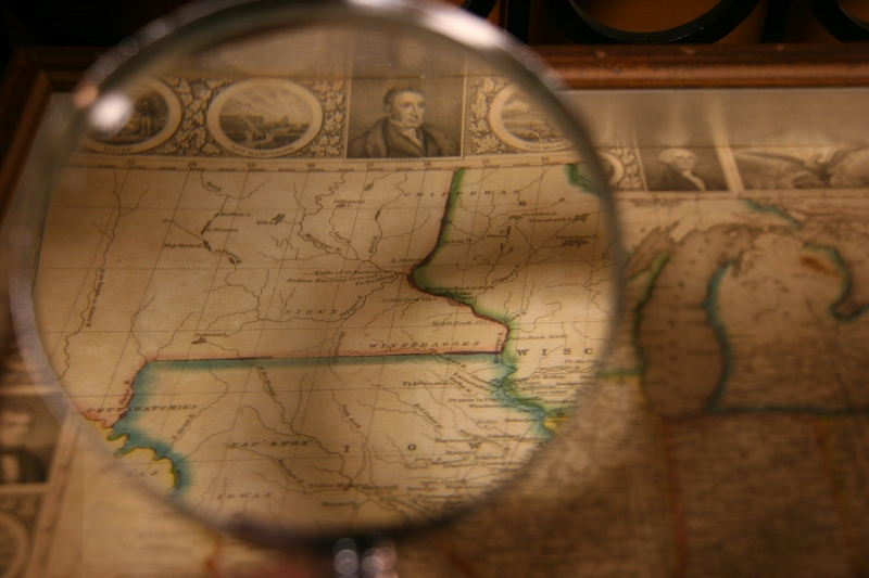 "Inside the main museum building, I studied a map with a magnifying glass. Minnesota was spelled with one ""n."""
