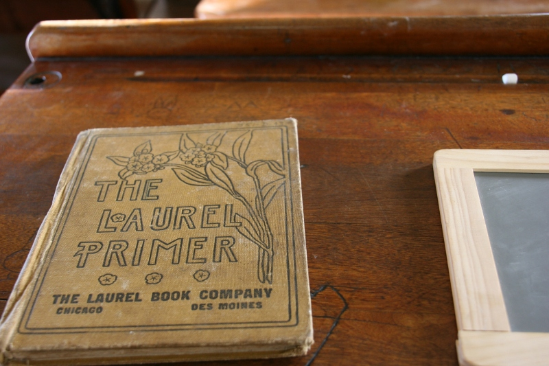 Old books were laid out on school desks.