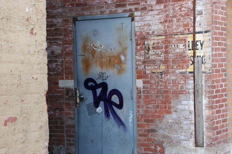 I notice details, even graffiti on a business side door.