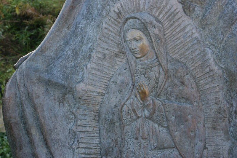 This image of the Lady of Guadalupe is woven into the Juan Diego statue.