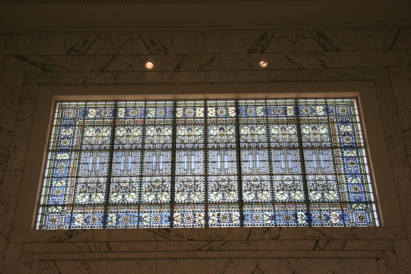 The largest of the Tiffany stained glass windows in the bank looms above the entry. Architect George Maher's Prairie School influences are seen in a design that includes a lotus pattern.