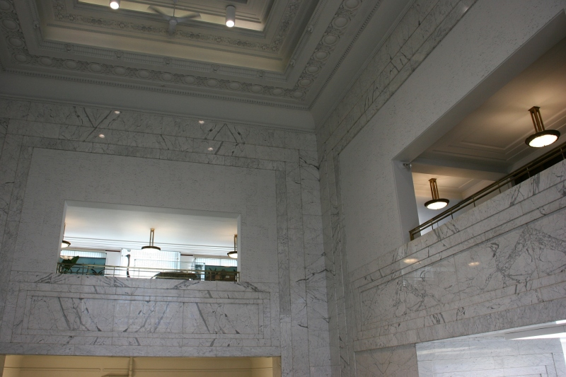 Looking up toward the second floor and the area open to the lower level, the white marble from Italy conveys strength.