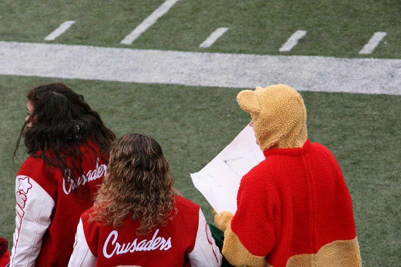 Crusaders fans, including Winnie the Pooh. Some students dressed in Halloween costumes.