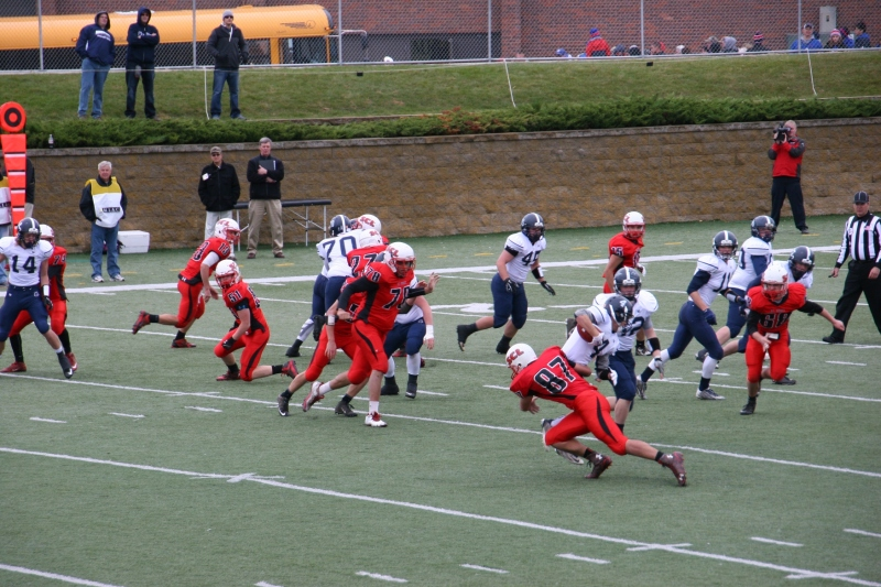 Stephen, #87, tackles the JCC player carrying the football.