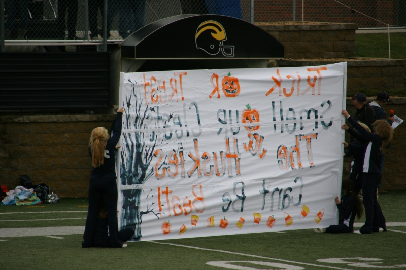 The Halloween themed sign held by the JCC cheerleaders.