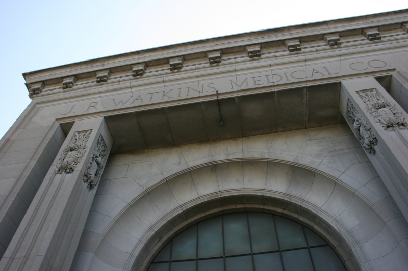 Chiseled above the main entry into the administrative building.