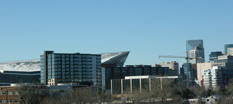 Behind the building in the foreground, you can see the pointed end of U.S. Bank Stadium.