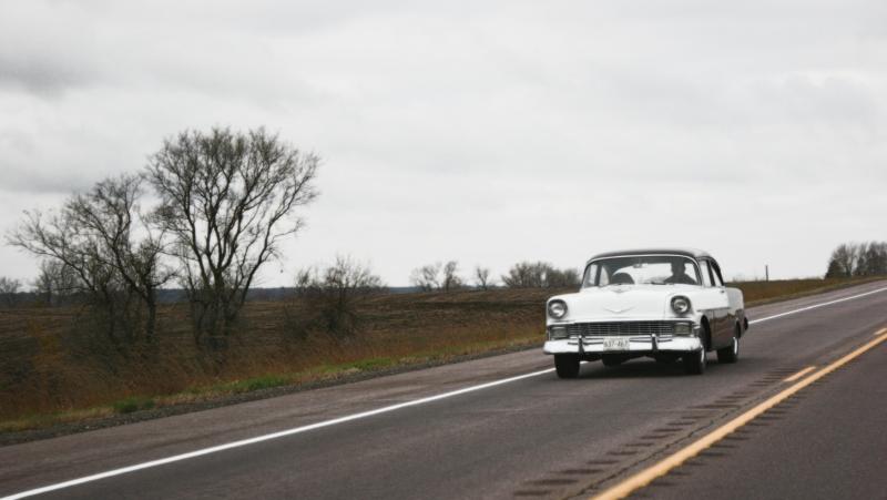 A vintage car travels eastbound along U.S. Highway 14 toward Nicollet.