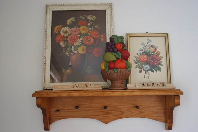 Given my love of words, I created this Thanksgiving display with thrift store art purchases and Scrabble letters.