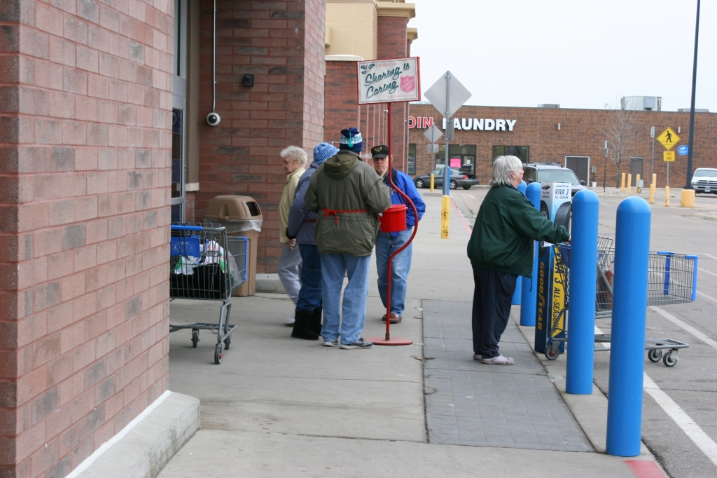 Members of Trinity Lutheran Church rang bells at various Faribault locations on Saturday. Here Bud and Bev ring outside of Walmart.