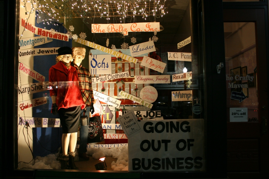 The Crafty Maven created this window display for the vintage themed division of the holiday window decorating contest. The display highlights businesses that were in Faribault when Maven sisters and owners Beth Westerhouse and Dee Bjork were growing up here.