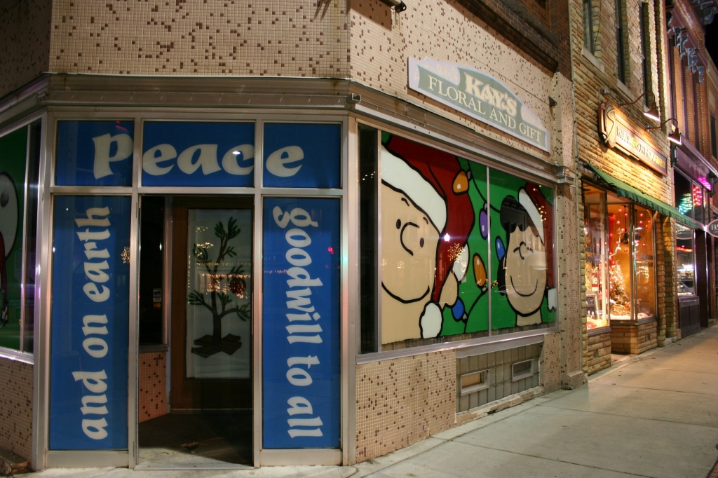 Peanuts characters adorn the former Kay's Floral building on the corner of Central Avenue and Fourth Street/Minnesota State Highway 60.
