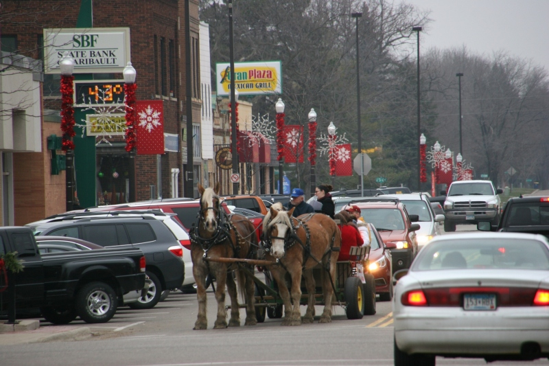 Mike Fuchs guides his team or horses southbound on Central Avenue in historic downtown Faribault late Saturday afternoon.