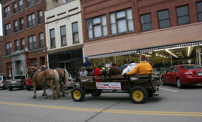 Mike Fuchs guided his horses along Central Avenue on Saturday afternoon for free rides in Santa's Wagon.