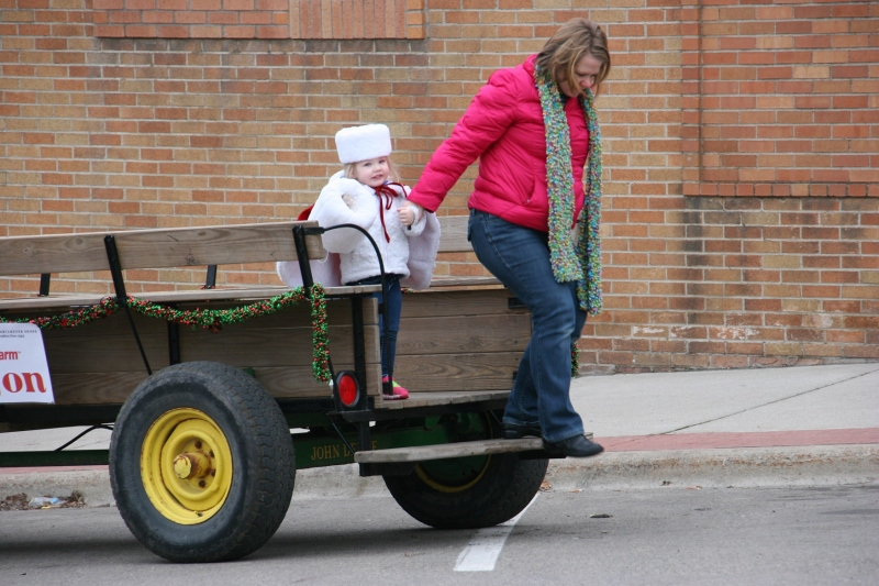 After a ride through downtown Faribault in a horse-drawn wagon, Lyla and her mom exited by the KC Hall.