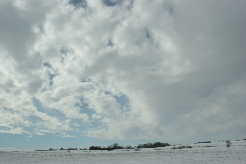 To the west of Interstate 35, clouds billow above snow-washed fields.