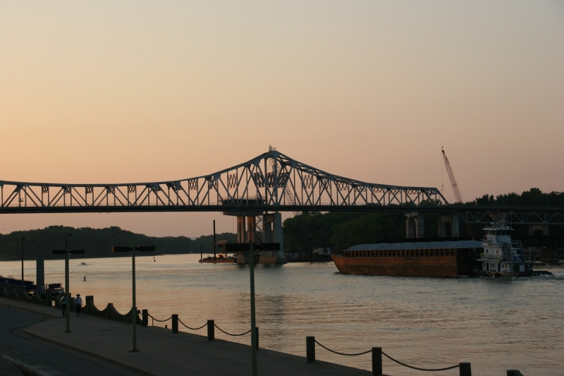 A barge floats near the Mississippi River bridge that connects Minnesota and Wisconsin in Winona.