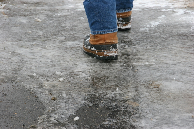 Nature Center, 17 walking across icy parking lot
