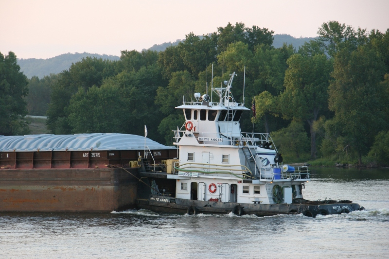 Pulling a barge down the Mississippi River in Winona in September 2015.