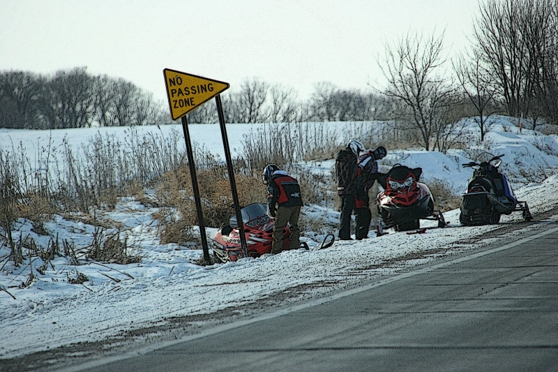 With windchills in the minus 20-degree range, Saturday afternoon, these snowmobilers dealt with machine break-down issues in the countryside.