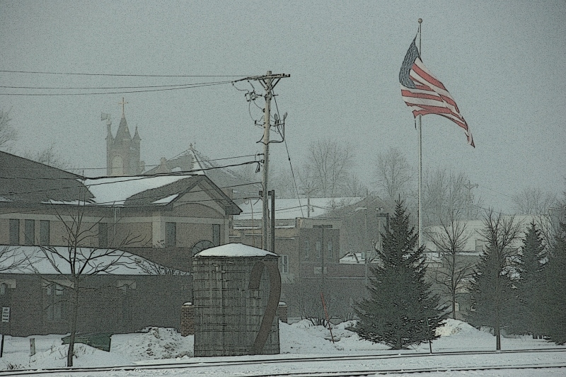 Saturday afternoon in Montgomery, fierce wind whipped this over-sized flag and a light snowfall.