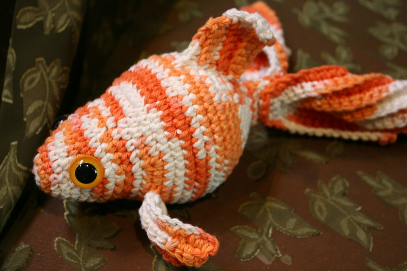 God's creation of fish depicted in this crocheted art piece.