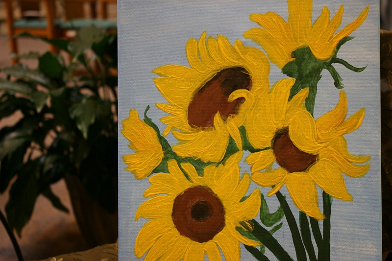 A painting of sunflowers jolted color