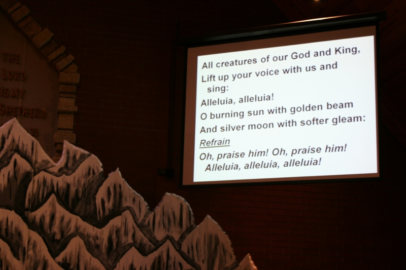 "Worship opened with the hymn, ""All Creatures of Our God and King,"" shown on the big screen next to a mountain crafted for the 2015 Mt. Everest themed Vacation Bible School."