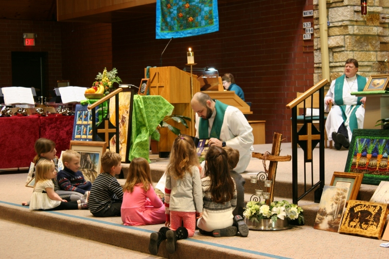 The Rev. Paul Rieger uses a book to showcase Creation during the children's object lesson.