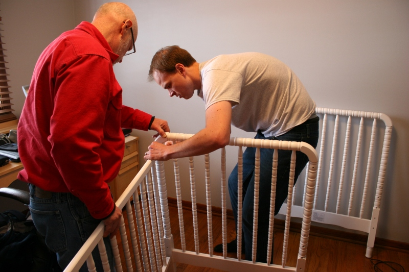 My husband and son-in-law assemble Baby Girl's crib.