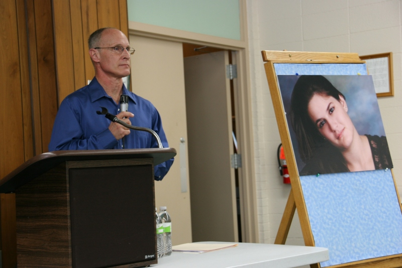 Dan Kasper next to a portrait of Becky.
