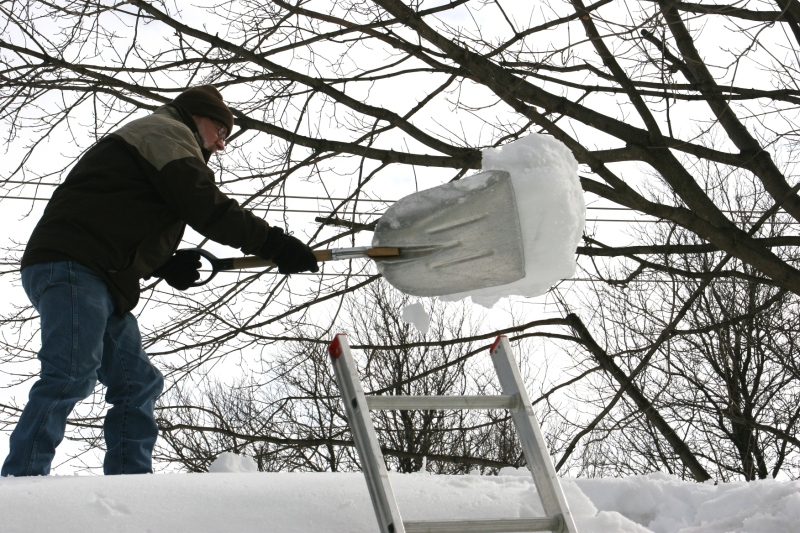 Shoveling snow off roof, 68