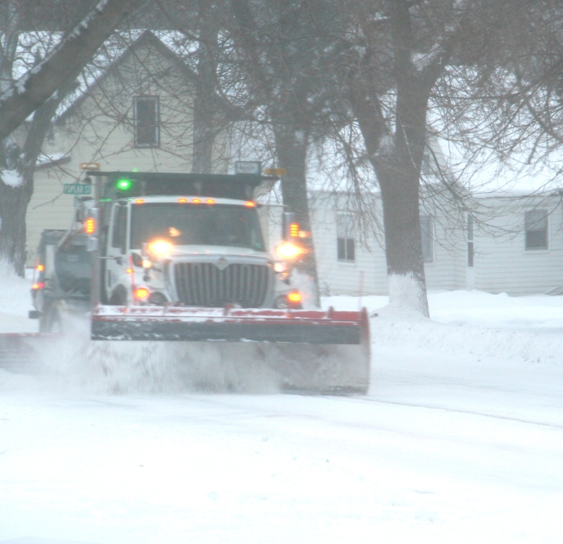 A City of Faribault truck plows snow on the street past my house Tuesday afternoon.
