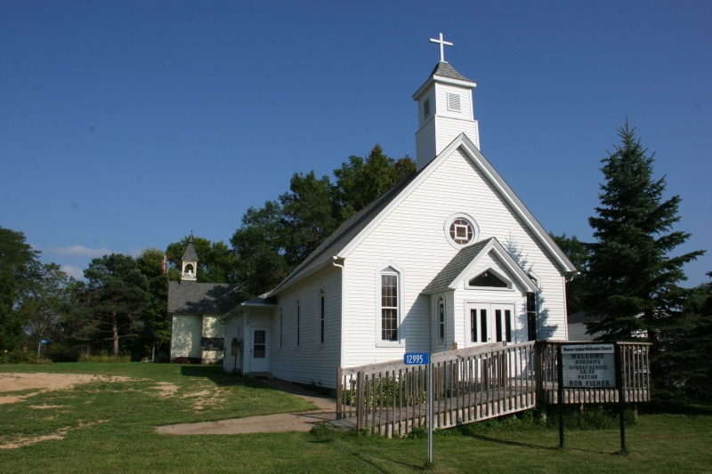 Weaver United Methodist Church with the historic former schoolhouse next door.