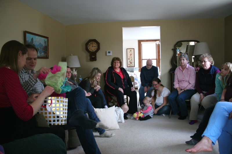 A snippet shot of guests gathered in my living room for gift opening at the baby shower.