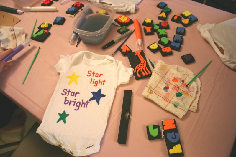 Guests created personalized onesies using stamps, stencils, paint and permanent markers.