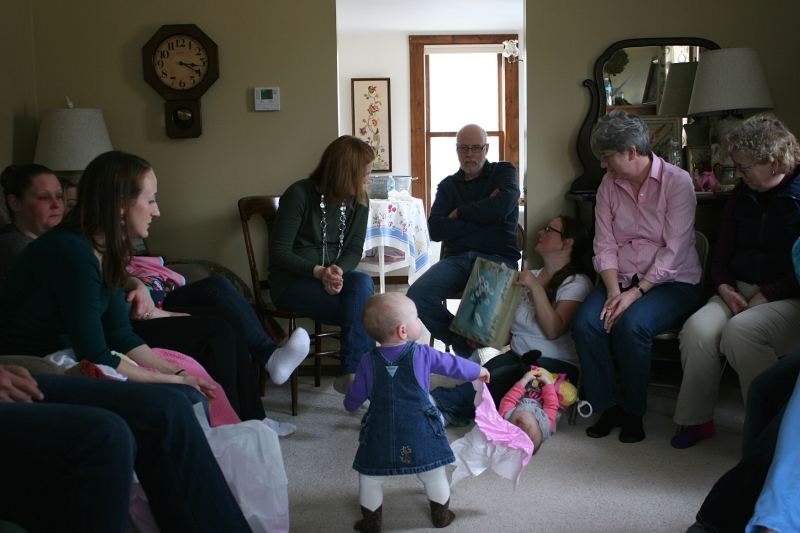 The great nieces played while their moms and others passed opened baby gifts around my living room.