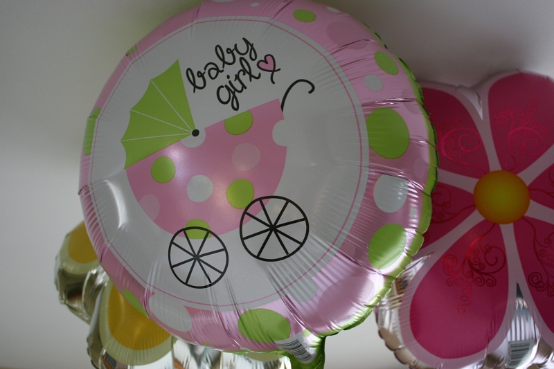 I picked up three helium balloons for my daughter and son-in-law's baby shower for a total of $3 at Dollar Tree.