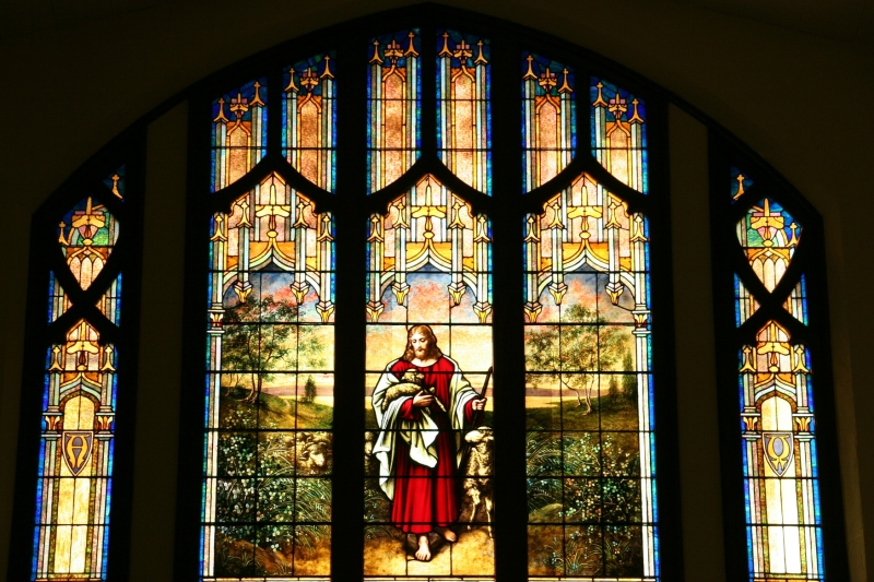 Stained glass windows fill the sanctuary, including this one in the balcony.