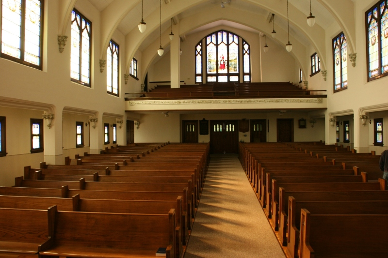 Looking from the front of the sanctuary to the rear and the balcony.