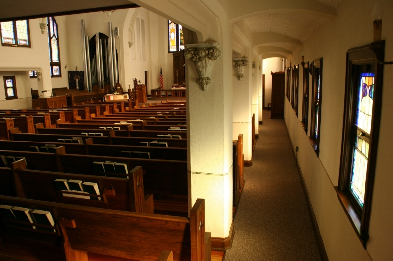 A view of a sanctuary side aisle showcases the craftsmanship of this church.