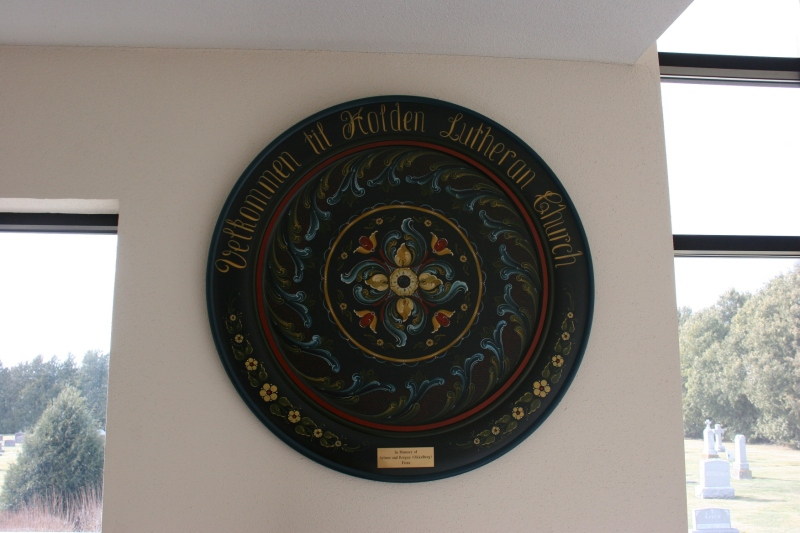 Holden's Norwegian heritage is reflected in this rosemaling art hung in the narthex.