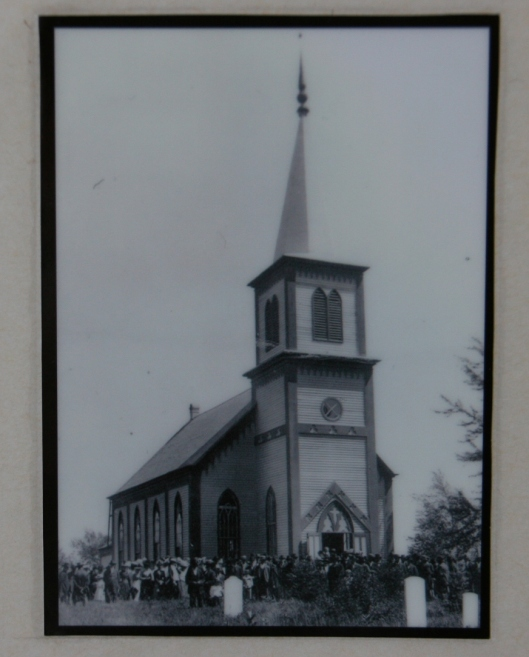 "A photo of the ""old church"" is posted in the present church."