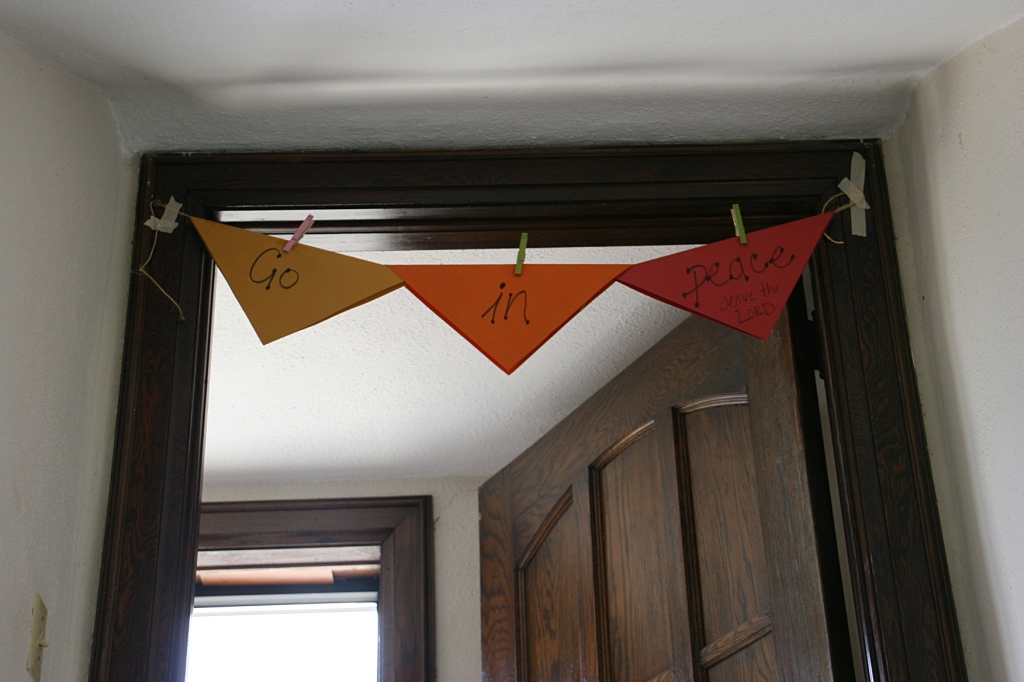 A simple banner message for those exiting the church entry to the south.